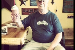 One of our regular customers enjoying his favorite frappe.