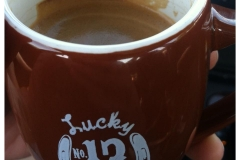 Some delicious Lucky #13 espresso in our adorable espresso cups.