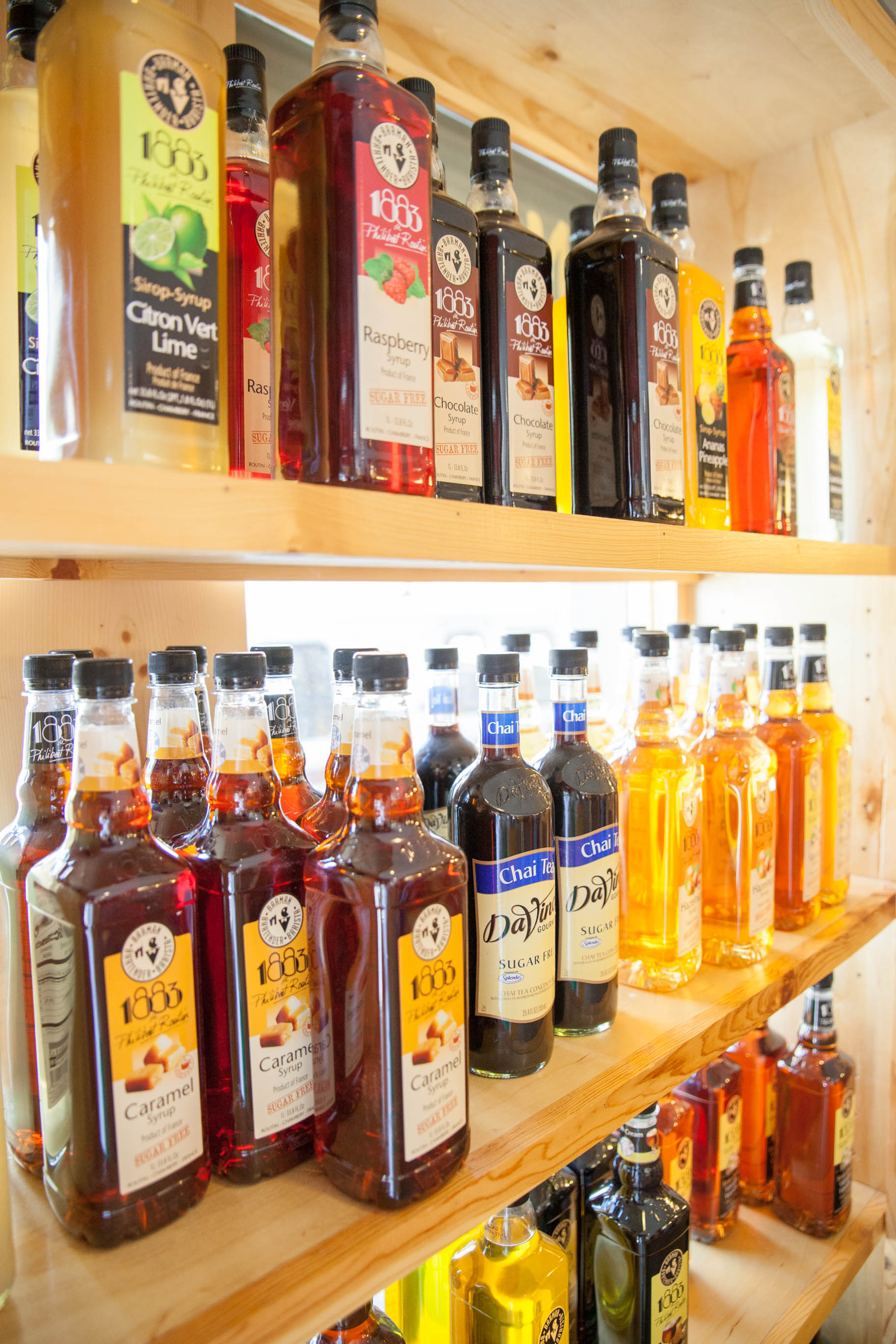 Some of the many syrups we use. Photo by Jordana Snyder Photograpy.
