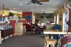 Our Forest City store interior. Take a load off on our couches and play a board game with some friends!